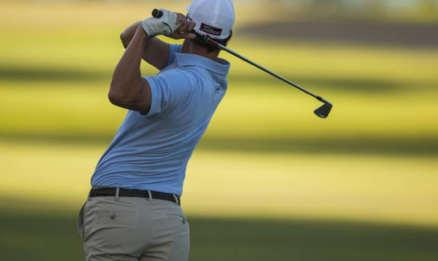 Adam Scot, of Australia, follows his fairway shot on No. 13 during the first round of the Sony Open golf tournament, Thursday, Jan. 9, 2014, in Honolulu. (AP Photo/Marco Garcia)