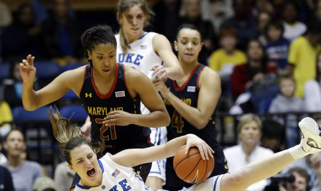 Duke's Haley Peters (33) falls as Maryland's Tianna Hawkins (21) defends during the second half of an NCAA college basketball game in Durham, N.C., Monday, Feb. 11, 2013. Duke won 71-56. (AP Photo/Gerry Broome)