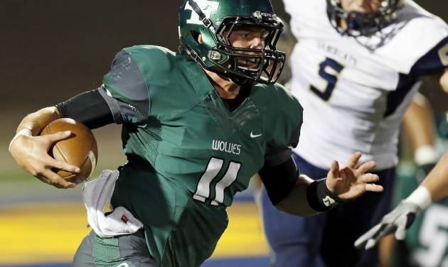 Edmond Santa Fe's Justice Hansen (11) keeps the ball during a high school football game between Edmond Santa Fe and Southmoore at Wantland Stadium in Edmond, Okla., Thursday, Sept. 20, 2012. Photo by Nate Billings, The Oklahoman