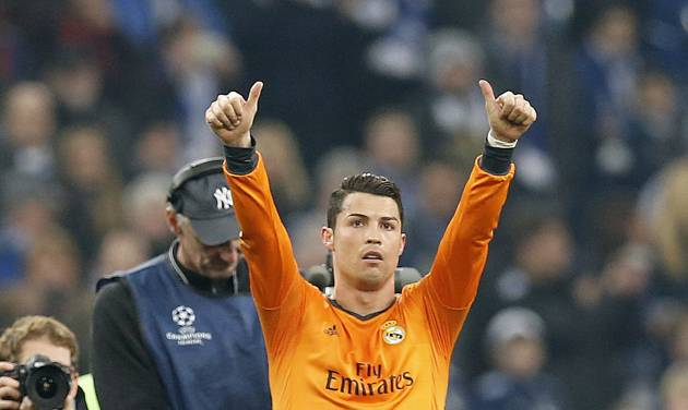 Real's Cristiano Ronaldo gestures after the Champions League round of the last 16 first leg soccer match between Schalke 04 and Real Madrid in Gelsenkirchen, Germany, Wednesday, Feb.26,2014. (AP Photo/Frank Augstein)