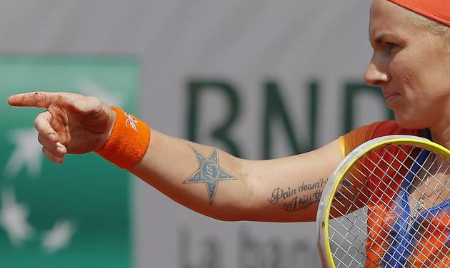 Russia's Svetlana Kuznetsova asks for her towel after falling on the clay as he plays Petra Kvitova, of the Czech Republic, during their third round match of  the French Open tennis tournament at the Roland Garros stadium, in Paris, France, Saturday, May 31, 2014. (AP Photo/Michel Spingler)