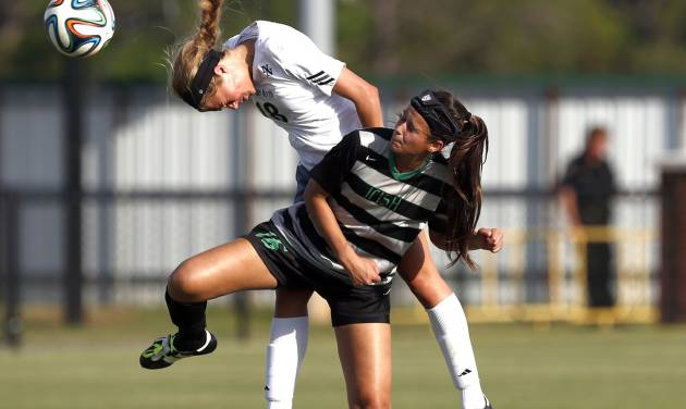 Norman North's Luka Joyner heads a ball as Bishop MicGuiness' Quincy Plank defends during the high school girls soccer between Bishop McGuinness and Norman North at Norman North High School in Norman, Okla., Friday, May 9, 2014. Photo by Sarah Phipps, The Oklahoman