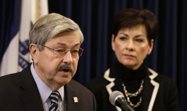 Iowa Gov. Terry Branstad speaks during a news conference as Lt. Gov. Kim Reynolds looks on during the opening day of the Iowa Legislature, Monday, Jan. 14, 2013, at the Statehouse in Des Moines, Iowa. (AP Photo/Charlie Neibergall)