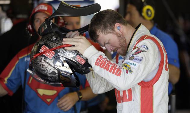 Driver Dale Earnhardt Jr., prepares for his qualifying session for the NASCAR Sprint Cup series auto race at Michigan International Speedway in Brooklyn, Mich., Saturday, June 14, 2014. (AP Photo/Carlos Osorio)