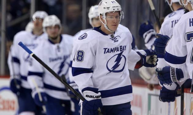 Tampa Bay Lightning's Ondrej Palat (18) celebrates his second-period goal against the Winnipeg Jets during an NHL hockey game Tuesday, Jan. 7, 2014, in Winnipeg, Manitoba. (AP Photo/The Canadian Press, Trevor Hagan)
