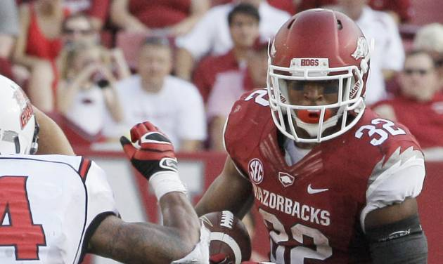 FILE - In this Aug. 31, 2013, file photo, Arkansas running back Jonathan Williams (32) carries past Louisiana-Lafayette defenders during the second half of an NCAA college football game in Fayetteville, Ark. Williams is returning to the Razorbacks in the 2014 season. (AP Photo/Danny Johnston, File)