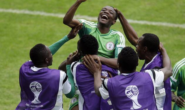 Nigeria's Ahmed Musa, center, celebrates with teammates after scoring his side's 2nd goal during the group F World Cup soccer match between Nigeria and Argentina at the Estadio Beira-Rio in Porto Alegre, Brazil, Wednesday, June 25, 2014. (AP Photo/Michael Sohn)