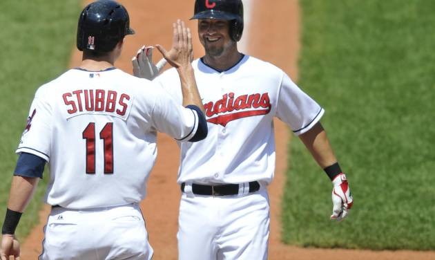 Cleveland Indians right fielder Ryan Raburn, right, celebrates his two-run home run with center fielder Drew Stubbs against the Chicago White Sox in the third inning of a baseball game, Thursday, August 1, 2013, in Cleveland. (AP Photo/David Richard)