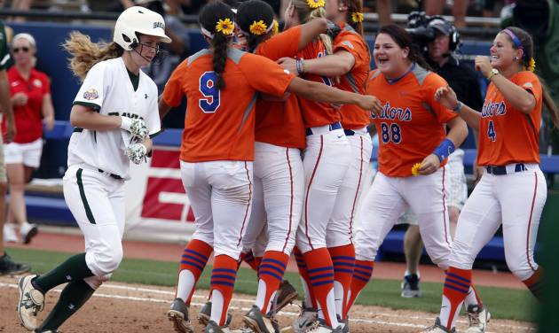 Florida celebrates their win in front of Baylor's Robin Landrith (17) during of the Women's College World Series softball tournament game between Baylor University and University of Florida at ASA Hall of Fame Stadium in Oklahoma City, Sunday, June 1, 2014. Photo by Sarah Phipps, The Oklahoman