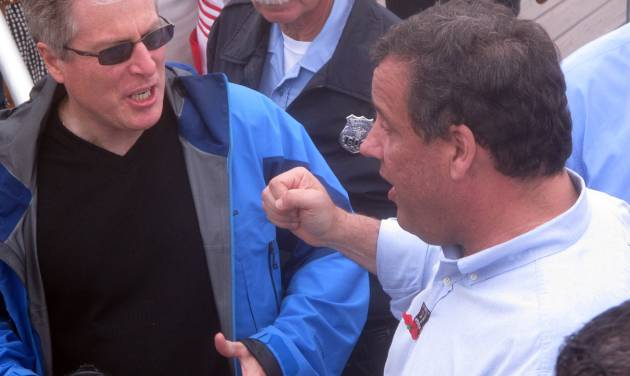 George Lewis of Spring lake, left, speaks with New Jersey Gov. Chris Christie on Friday May 23, 2014 on the Belmar N.J. beachfront. Christie said the Jersey shore is open for business and has  made great strides recovering from Superstorm Sandy in Oct. 2012. (AP Photo/Wayne Parry)