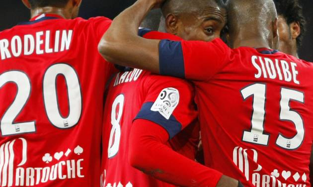 Lille's Salomon Kalou, center, is congratulated by teammates after he scored during their French League one soccer match against Rennes  at the Lille Metropole stadium, in Villeneuve d'Ascq, northern France, Friday, Jan. 24, 2014. (AP Photo/Michel Spingler)