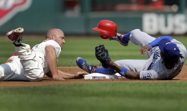St. Louis Cardinals' Matt Holliday, left, gets back to second on a failed pickoff attempt as Los Angeles Dodgers shortstop Hanley Ramirez covers during the first inning of a baseball game Saturday, July 19, 2014, in St. Louis. (AP Photo/Jeff Roberson)