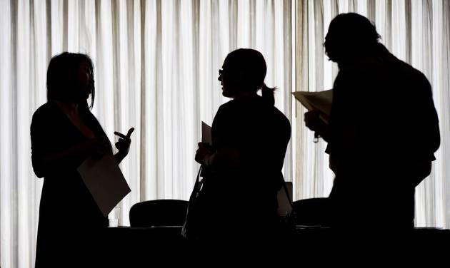 In this June 23, 2014 photo, recruiter Christina O, left, with New Western Acquisitions, meets with employment seekers during a job fair in Philadelphia. The Labor Department reports on the number of people who applied for unemployment benefits last week on Thursday, Sept. 4, 2014. (AP Photo/Matt Rourke)