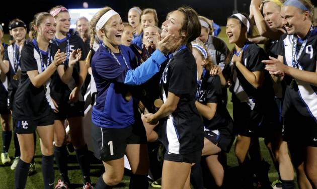 Deer Creek celebrates with the trophy after winning the Class 5A girls state soccer championship between Deer Creek and Carl Albert in Norman, Okla., Saturday, May 17, 2014. Photo by Bryan Terry, The Oklahoman