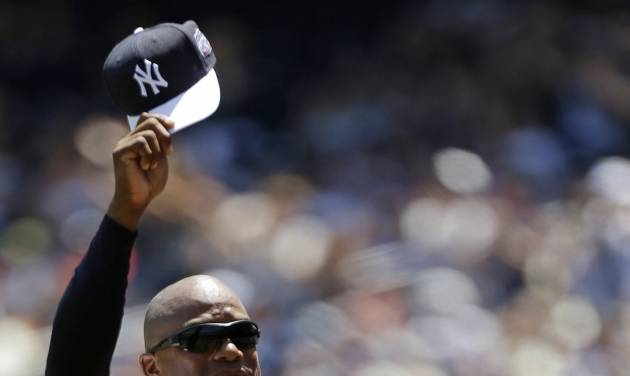 """FILE - In this June 23, 2013 file photo, former New York Yankees pitcher Orlando """"El Duque"""" Hernandez tips his cap to the crowd as he is introduced before the Yankees 67th Old Timers Day baseball game  in New York. Hernandez has re-joined the New York Yankees as a minor league spring training pitching instructor. The Cuban right-hander said Tuesday, March 4, 2014,  he will be at the team's minor league complex for the next few weeks. (AP Photo/Kathy Willens, File)"""