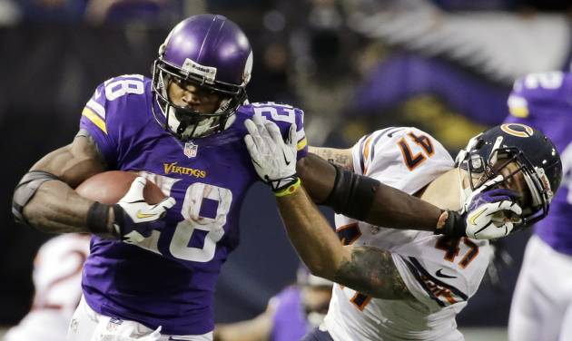 Minnesota Vikings running back Adrian Peterson, left, tries to break a tackle from Chicago Bears free safety Chris Conte during the fourth quarter of an NFL football game on Sunday, Dec. 1, 2013, in Minneapolis. The Vikings won 23-20 in overtime. (AP Photo/Ann Heisenfelt)