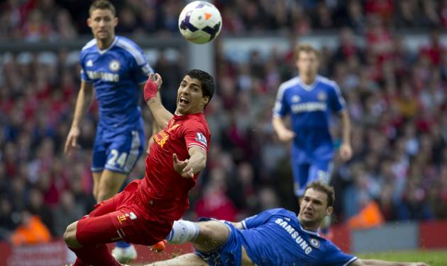 Liverpool's Luis Suarez, centre left, is thwarted by Chelsea's Branislav Ivanovic during their English Premier League soccer match at Anfield Stadium, Liverpool, England, Sunday, April 27, 2014. (AP Photo/Jon Super)