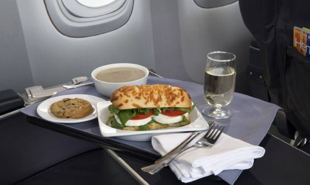This product image provided by United Airlines shows a Caprese on Asiago Baguette sandwich, one of a variety of the airline's new first class food options.  The Chicago-based airline on Thursday, Aug. 21, 2014 announced that it's upgrading first class food options and replacing snacks with full meals on some of its shortest flights. (AP Photo/United Airlines)