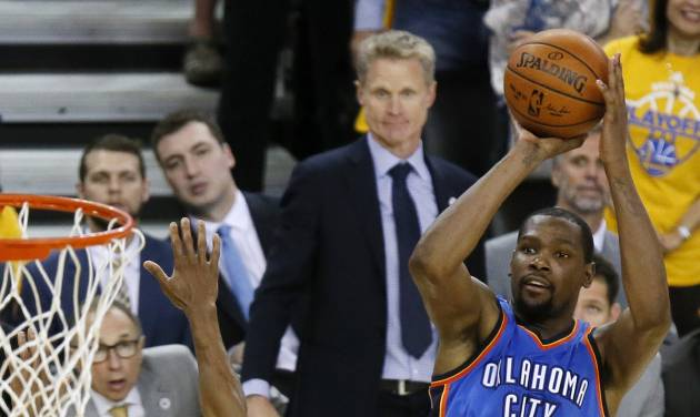 Oklahoma City\'s Kevin Durant (35) shoots against Golden State\'s Andre Iguodala (9) as Warriors...