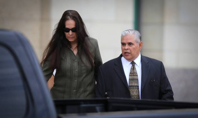 Former 404th state District Judge Abel Limas, right, quickly exits the federal courthouse in Brownsville, Texas on Wednesday, Aug. 21, 2013. Limas, who turned his courtroom into a money-making operation, was sentenced Wednesday to six years in prison followed by three years of unsupervised release on one count of racketeering in Brownsville.  (AP Photo/The Brownsville Herald, Yvette Vela)
