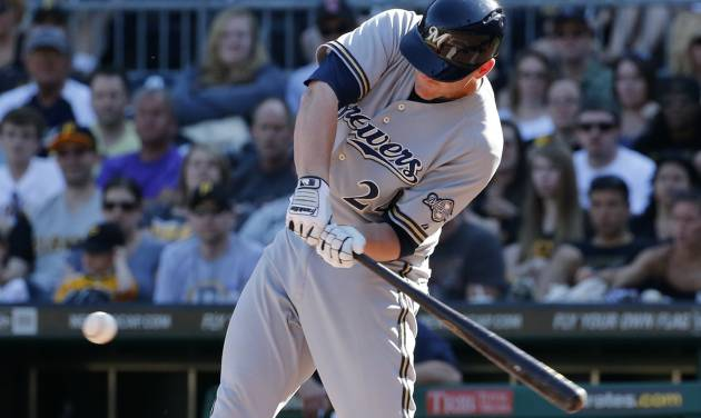 Milwaukee Brewers' Lyle Overbay (24) drives in two runs with a single off Pittsburgh Pirates starting pitcher Edinson Volquez during the fourth inning of a baseball game in Pittsburgh Saturday, June 7, 2014. (AP Photo/Gene J. Puskar)