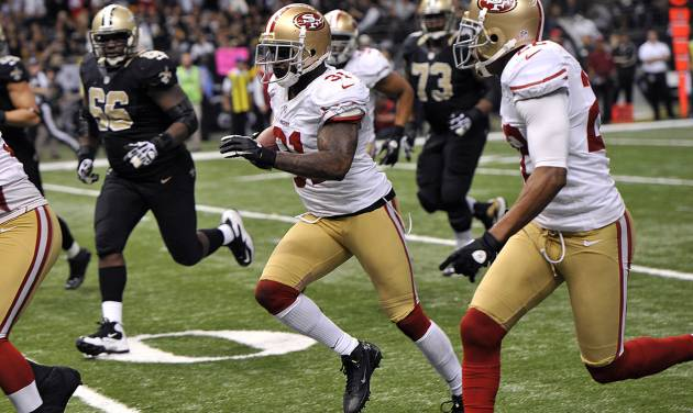 San Francisco 49ers strong safety Donte Whitner (31) scores on a touchdown run in the second half of an NFL football game against the New Orleans Saints at the Louisiana Superdome in New Orleans, Sunday, Nov. 25, 2012. (AP Photo/Bill Feig)