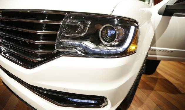 The new 2015 Lincoln Navigator is unveiled in Detroit, Tuesday, Jan. 21, 2014. Lincoln Motor Co. _ Ford's luxury arm _ says the new Navigator will have more than 20 upgrades, from bigger wheels and a leather-wrapped steering wheel to a 3.5-liter EcoBoost V6 engine to replace its old V8. Lincoln plans to publicly unveil the vehicle at the Chicago Auto Show. The SUV _ which will be built in Kentucky _ goes on sale this fall. (AP Photo/Carlos Osorio)