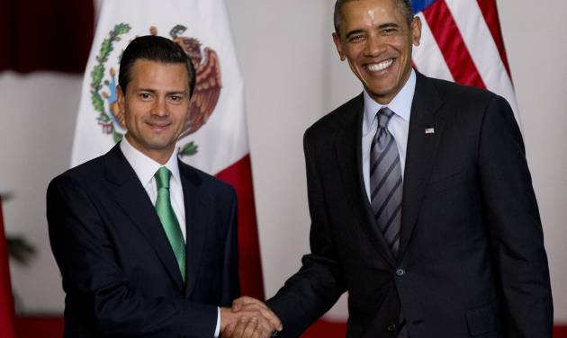 Mexico's President Enrique Pena Nieto, left, and President Barack Obama pose for photographers at the North American Leaders Summit in Toluca, Mexico, Wednesday, Feb. 19, 2014. Obama is in Toluca for the one-day summit with Mexican and Canadian leaders, meeting on issues of trade and other neighbor-to-neighbor interests, even as Congress is pushing back against some of his top cross-border agenda items. (AP Photo/Eduardo Verdugo)