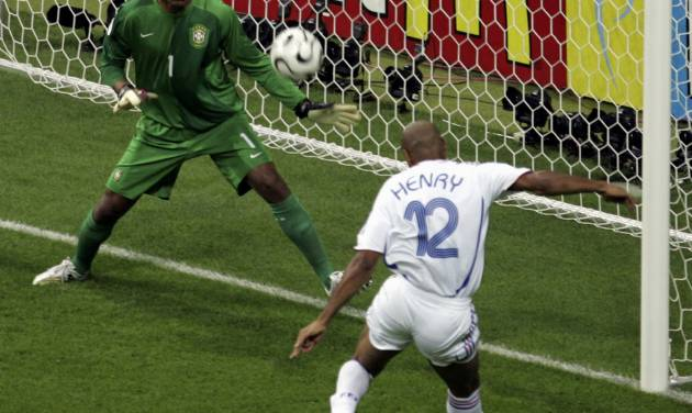 FILE - In this July 1, 2006 file photo, France's Thierry Henry, right, scores past Brazil goalkeeper Dida, during their World Cup quarterfinal soccer match, in Frankfurt, Germany. On this day: France beats Brazil 1-0 to claim a surprise semifinal berth. (AP Photo/ Lionel Cironneau, File)