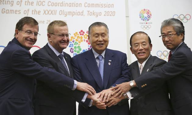 From left, IOC Executive Director for the Olympic Games Gilbert Felli, IOC Vice President John Coates, Tokyo Organizing Committee of the Olympic and Paralympic Games President Yoshiro Mori, Chief Executive Officer Toshiro Muto, and Tsunekazu Takeda, a member of the International Olympic Committee and president of Japanese Olympic Committee, join hands to pose for photographers during a press conference after the first coordination commission meeting for the Tokyo 2020 Games, in Tokyo Friday, June 27, 2014. The IOC wrapped up its first coordination commission meeting on Friday, saying any changes to the venue plan should not alter the core principles of the city's winning bid. Japanese Olympic organizers are reviewing their venue plans because of concerns over costs and have suggested some venues may have to be moved. (AP Photo/Koji Sasahara)