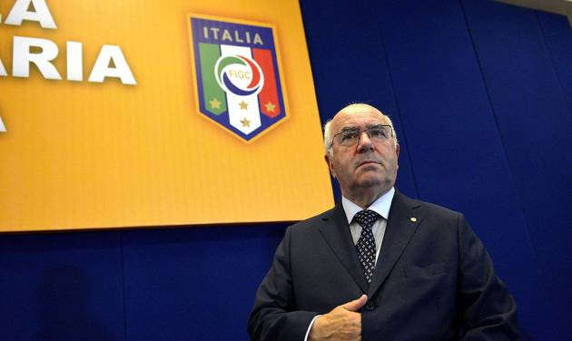 """In this picture taken Friday, July 25, 2014, Carlo Tavecchio attends an assembly of the National Amateur League in Rome. FIFA has asked the Italian football federation to open an investigation into alleged racist comments made by FIGC presidential candidate Carlo Tavecchio. """"Media reports concerning alleged racist comments by one of the presidential candidates for the Italian FA have alerted FIFA's Task Force against racism and discrimination and its chairman Jeffrey Webb,"""" a statement by world football's governing body said on Monday, July 28, 2014. Amateur leagues president Tavecchio sparked outrage on Friday when he discussed the presence of foreign players in Italy. Using a hypothetical name, he said, """"In England they select players based on professionalism, whereas we say that 'Opti Poba' is here, he was eating bananas before and now he's starting for Lazio and that's OK."""" (AP Photo/Daniele Leone, LaPresse)"""