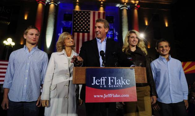 U.S. Senate candidate Jeff Flake and his family greet supporters during a campaign stop ahead of the election at the Yavapai County Courthouse Plaza Monday, Nov. 5, 2012, in Prescott, Ariz. The stop on the courthouse steps has been a tradition of Republicans since 1964 when Barry Goldwater concluded his presidential campaign there. (AP Photo/The Daily Courier, Les Stukenberg) MANDATORY CREDIT