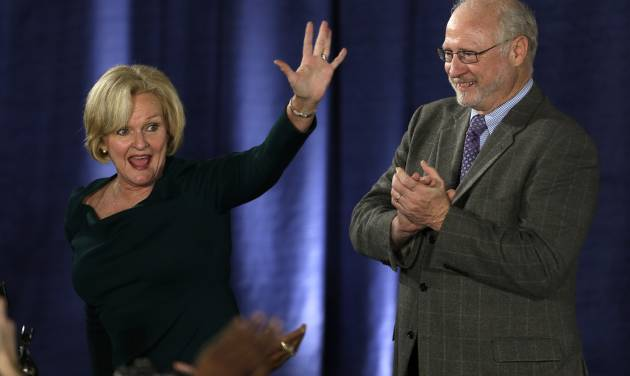 Sen. Claire McCaskill, D-Mo., waves to supporters alongside her husband, Joseph Shepard, right, after declaring victory over challenger Rep. Todd Akin, R-Mo., in the Missouri Senate race Tuesday, Nov. 6, 2012, in St. Louis. (AP Photo/Jeff Roberson)