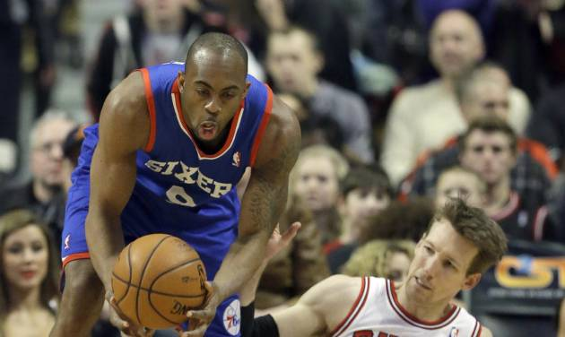Philadelphia 76ers guard James Anderson (9), left, battles for a loose ball against Chicago Bulls guard Mike Dunleavy (34) during the first half of an NBA basketball game in Chicago, Saturday, Jan. 18, 2014. (AP Photo/Nam Y. Huh)