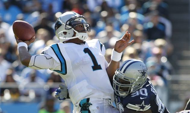 Carolina Panthers quarterback Cam Newton (1) tries to get off a pass as Dallas Cowboys nose tackle Jay Ratliff (90) tackles him during the second half of an NFL football game, Sunday, Oct. 21, 2012, in Charlotte, N.C. (AP Photo/Bob Leverone)
