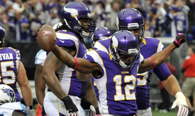 Minnesota Vikings wide receiver Percy Harvin (12) celebrates after scoring a touchdown during the first half of an NFL football game against the Tennessee Titans, Sunday, Oct. 7, 2012, in Minneapolis. (AP Photo/Jim Mone)