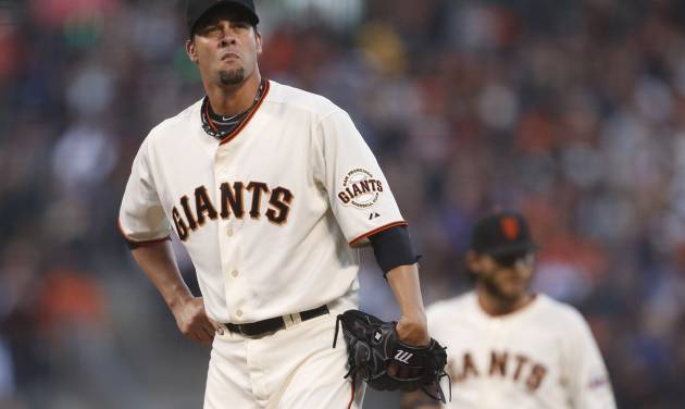 San Francisco Giants pitcher Ryan Vogelsong reacts after allowing a two-run single during the third inning of a baseball game against the Washington Nationals, Monday, June 9, 2014, in San Francisco. (AP Photo/Beck Diefenbach)