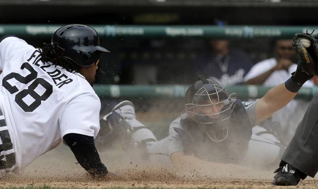 Detroit Tigers' Prince Fielder (28) slides home safely past the tag of Seattle Mariners catcher Mike Zunino, right, in the seventh inning of a baseball game in Detroit, Thursday, Sept. 19, 2013.  (AP Photo/Paul Sancya)