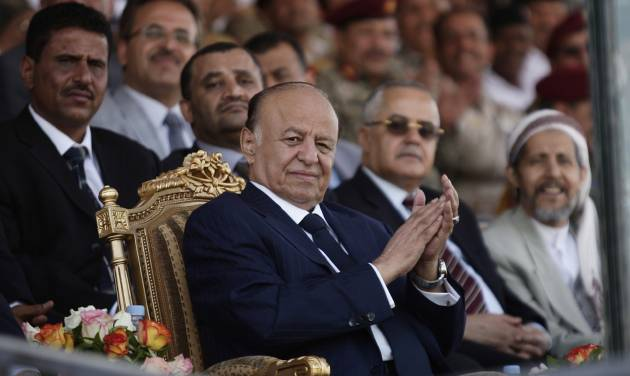 Yemeni President Abed Rabbu Mansour Hadi claps as he watches a parade during a ceremony to commemorate the 22nd anniversary of Yemen's reunification, in Sanaa, Yemen, Tuesday, May 22, 2012. Yemeni leaders led a somber ceremony Tuesday to mark the country's national day, scaling back the celebrations a day after a suicide bombing killed tens of soldiers during a rehearsal for a military parade. (AP Photo/Hani Mohammed)