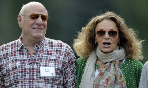 Fashion designer Diane von Furstenberg and her husband, media executive Barry Diller, arrive at the Allen & Company Sun Valley Conference in Sun Valley, Idaho. Diller is stepping down as chairman of TripAdvisor after selling his stake in the travel website to Liberty Interactive. Liberty Interactive bought 4.8 million shares of TripAdvisor Inc.'s common stock from Diller and The Diller-von Furstenberg Family Foundation for a total of about $300 million, making it the travel website's new majority shareholder.  (AP Photo/Paul Sakuma)