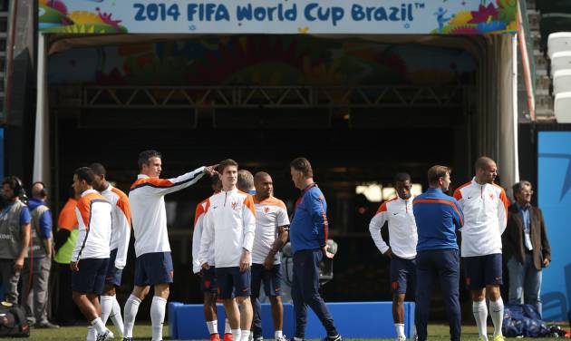 The Netherlands soccer team arrive for a training session at the Itaquerao Stadium in Sao Paulo, Brazil, Sunday, June 22, 2014.  The Netherlands will play Chile in a match that will decide the winner of Group B at the 2014 soccer World Cup. (AP Photo/Wong Maye-E)