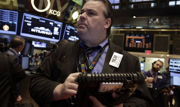 Trader Robert Hannan works on the floor of the New York Stock Exchange Friday, Jan. 31, 2014. Stocks fell sharply in early trading Friday, as investors fretted over disappointing earnings from companies like Amazon.com and more trouble in overseas markets. (AP Photo/Richard Drew)