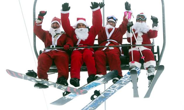 A group of Santas ride a chairlift, Sunday, Dec. 2, 2012, at the Sunday River Ski Resort in Newry, Maine. More than 250 skiers and snowboarders participated in the annual Santa Sunday event to raise money to benefit the Bethel Rotary Club's Christmas for Children program.(AP Photo/Robert F. Bukaty)