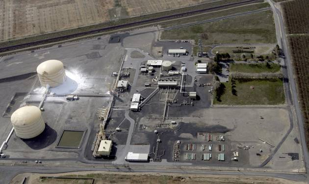 In this aerial photo, the Williams Northwest Pipeline plant is seen after a large explosion and fire in Plymouth, Wash., Monday, March 31, 2014. Benton County Sheriff Steven Keane said some gas leaked from the tank to the ground in a containment area and evaporated into the air, but it was only a small amount. (AP Photo/The Tri-City Herald, Sarah Gordon)