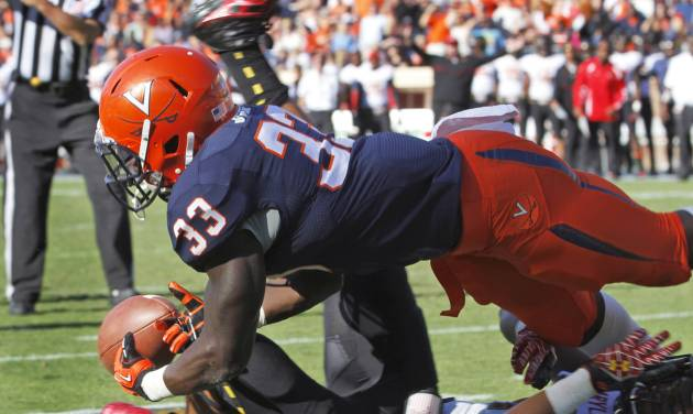 Virginia running back Perry Jones (33) dives for the ball in the end zone over Maryland defensive back Anthony Nixon during the first half of an NCAA college football game in Charlottesville, Va., Saturday, Oct. 13, 2012. The pass was incomplete. (AP Photo/Steve Helber)