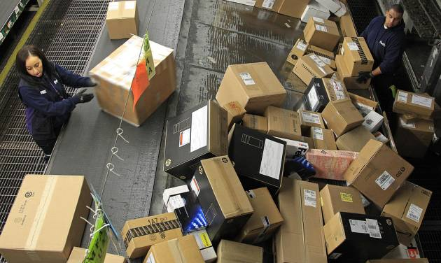 FILE - In this Tuesday, Dec. 11, 2012 file photo, FedEx workers sort packages at the Oakland Regional Sort Facility in Oakland, Calif. On Wednesday, Feb. 13, 2013, the government reports how much U.S. businesses adjusted their stockpiles in December.  (AP Photo/Ben Margot, File)