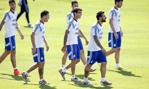 Argentine players walk during a training session in Vespesiano, near Belo Horizonte, Brazil, Sunday, June 22, 2014.  Argentina plays in group F of the 2014 soccer World Cup. (AP Photo/Victor R. Caivano)
