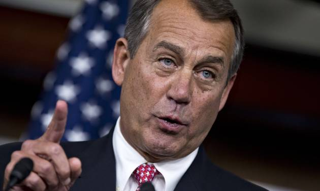 "House Speaker John Boehner of Ohio gestures during a news conference on Capitol Hill in Washington, Thursday, Dec. 13, 2012, where he accused President Barack Obama of not being serious about cutting government spending. Boehner is insisting that Obama wants far more in tax increases than spending reductions and appears willing to walk the economy ""right up to the fiscal cliff.""   (AP Photo/J. Scott Applewhite)"