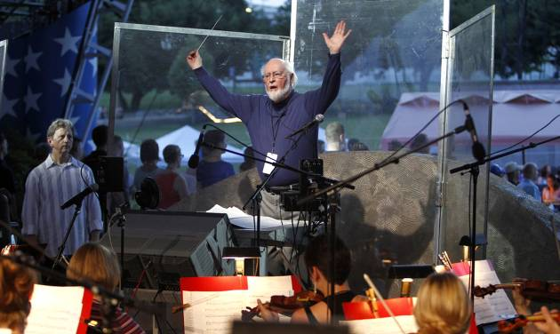 This handout photo provided by Capitol Concerts, taken July 2, 2014, shows John Williams conducting the National Symphony Orchestra and other musicians for the upcoming debut of a new arrangement of the national anthem, on Capitol Hill in Washington. It will be performed July 4 on the National Mall before the annual fireworks show. (AP Photo/Paul Morigi, Capitol Concerts)