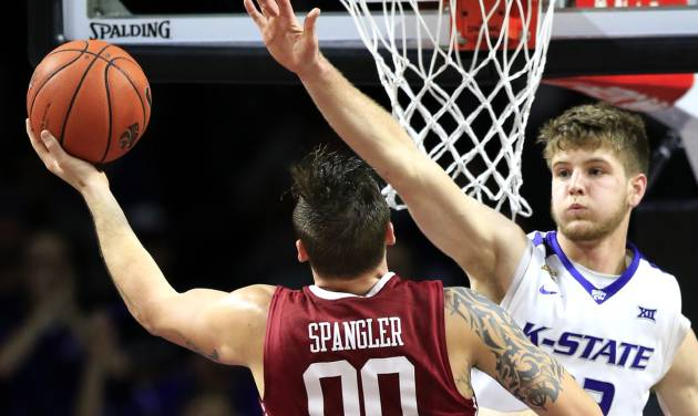 Oklahoma forward Ryan Spangler (00) shoots over Kansas State forward Dean Wade (32) during the second half of an NCAA college basketball game at Bramlage Coliseum in Manhattan, Kan., Saturday, Feb. 6, 2016. Kansas State defeated Oklahoma 80-69. (AP Photo/Orlin Wagner)
